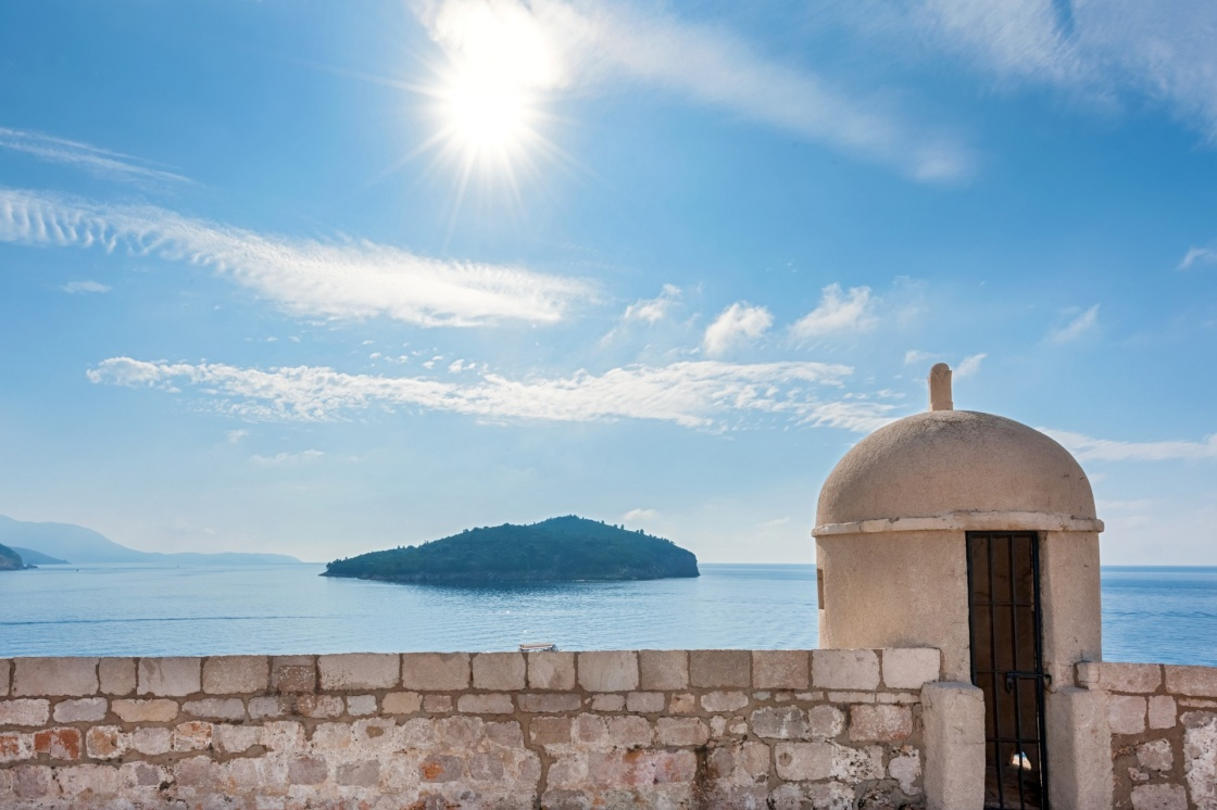 'Gun turret on old city walls of Dubrovnik city (Croatia) with island Lokrum in background.' - Dubrovnik