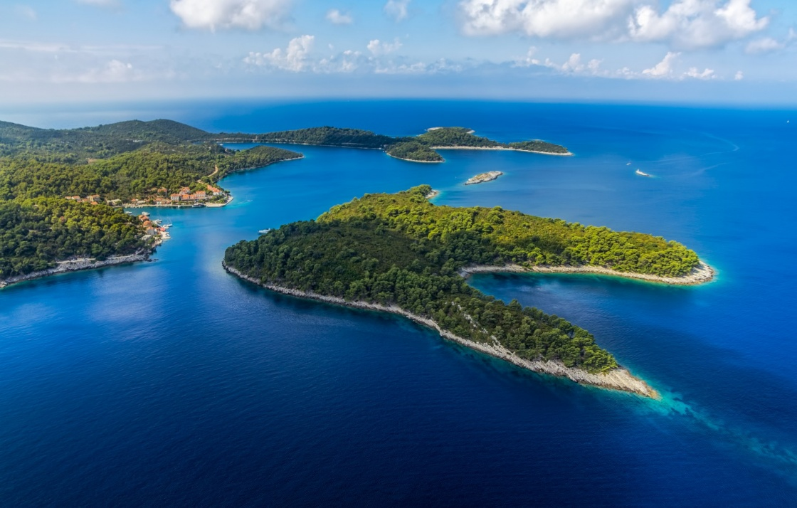 'Aerial helicopter shoot of National park on island Mljet, village Pomena, Dubrovnik archipelago, Croatia. The oldest pine forest in Europe preserved.' - Dubrovnik